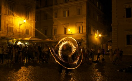 The Fire Lady performs in a piazza. Rome, Italy. (2013)