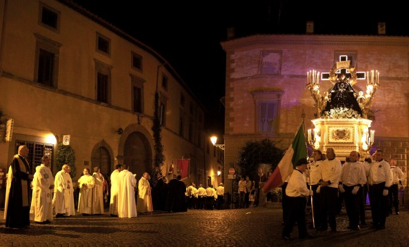 The Processione di Santa Maria makes a stop in San Marco Piazza. Tuscania, Italy. (2013)
