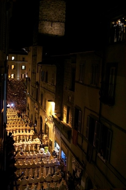 The Facchini march through the town of Viterbo, Italy on their way to the Macchinia. (2013)