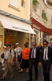 People walk in the shopping district on the Island of Capri, Italy. (2013)