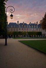 The sun sets on a public park in Paris, France. (2013)