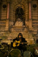 A musician performs in the St. Michel district of Paris, France. (2013)