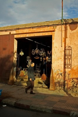 A man walks past an workshop in Marrakech, Morocco. (2013)