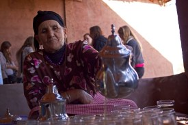 Fatima, the eldest woman of a native Berber family in the Ourika Valley, prepares mint tea for visiting American students. Marrakech, Morocco. (2013)