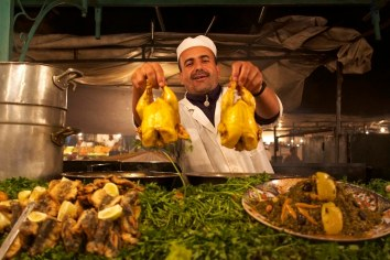A cook at a pop-up restaurant in the Jemaa el-Fnaa square. Marrakech, Morocco. (2013)