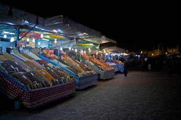 Street vendor stands in Jemaa el-Fnaa square. Marrakech, Morocco. (2013)