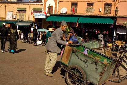 Street vendors and makeshifts buggies crowd the plazas inside the media of Marrakech, Morocco.