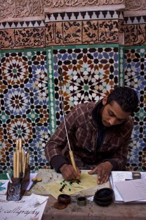 An artist writes names in Arabic calligraphy for visitors at the University of al-Karaouine, Marrakech, Morocco. (2013)