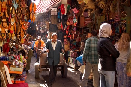 A man pulls a cart through the small side streets inside the medina of Marrakech, Morocco. (2013)