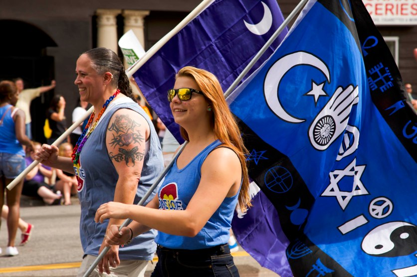 "Participants carry ""Coexist Flags"" in the Denver Pridefest Parade on June 21, 2015."