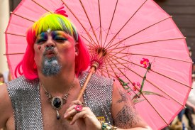 A participant in the Denver Pridefest Parade on June 21, 2015 poses for the camera. This year's Pridefest brought 370,00 to Civic Center Park over the two-day event, according to GLBTColorado.org.