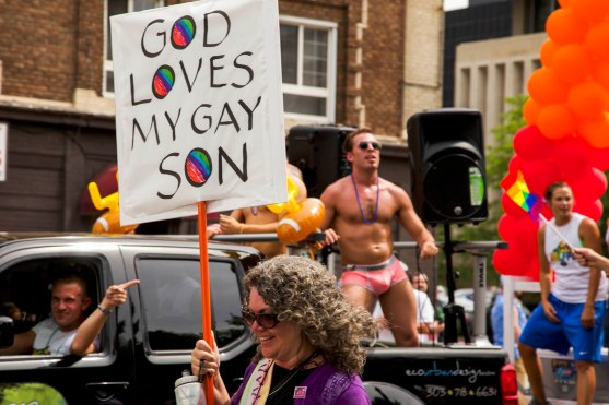 A woman carries a sign in the Denver Pridefest Parade on June 21, 2015. This year is the 40th anniversary of Denver's first gay pride event.