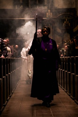 Roz Greene leads the clergy into St. John's Cathedral for Ash Wednesday service on Feb. 18, 2015, which begins the Christian holy season of Lent . Greens's role as Verger is to assist in various ceremonial aspects of the service.