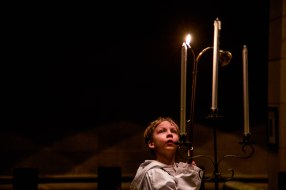 A young acolyte lights a candle at the beginning of the Compline and Benediction service at St. John's Cathedral in Denver, Colo. on March 4, 2015. This weekly Wednesday service is signified by quiet meditation and ancient chants performed by the choir in a candle-lit atmosphere.
