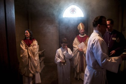A young acolyte wipes his eye as The Reverend Canon Elizabeth Marie Melchionna, far left, The Right Reverend John Pritchard, center, and other members of the clergy prepare for the Easter Sunday service amidst a haze of incense smoke on April 5, 2015.