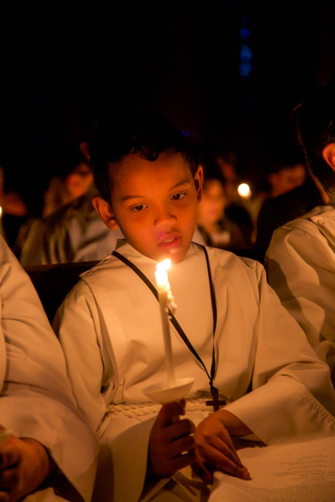 Elijah Dunning sits with other members of the clergy during the Easter Vigil service at St. John's Cathedral on April 4, 2015.