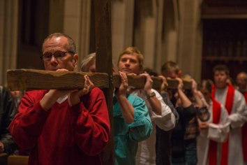 Michael Koechner, with fellow member of the congregation, carry a wooden cross into St. John's Cathedral in Denver, Colo. during the Good Friday service on April 3, 2015. This service commemorates the day Jesus was crucified and is one the most solemn days in the Christian year.