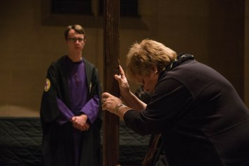 A parishioner shows respect to the Cross that stood in front of the altar at St. John's Cathedral in Denver, Colo. as part of the Good Friday service held on April 3, 2015. Good Friday commemorates the day Jesus was crucified. Easter Sunday follows two days later which celebrates his resurrection from death.