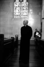 Dean Peter Eaton stands amongst the pews before the Lenten Tenebrae service on April 1, 2015. Eaton was the Dean of St. John's Cathedral in Denver, Colo. for 13 years, and was ordained the Bishop of Southeast Florida in May of 2015.