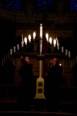 Vergers Michael Koechner, left, and Bill Sinch, right, put out candles during the Tenebrae service at St. John's Cathedral in Denver on April 1, 2015.