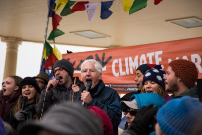 Peter Sawtell, center, is the executive director of Eco-Justice Ministries, and was the main coordinator of the day's COP21 Denver rally.