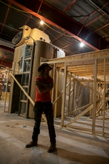 "Matt King, a founder of Meow Wolf, stands inside the 20,000 square foot complex that will house the interactive ""House of Eternal Return"" art exhibit, which opens on March 17 in Santa Fe, N.M."