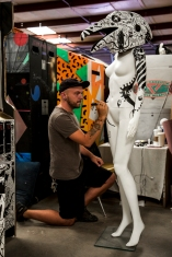"Nico Salazar decorates one of his pieces for ""House of Eternal Return"" on Sept. 10, 2015. Salazar works exclusively with black marker for this exhibit and is one of over 70 contributing artists."